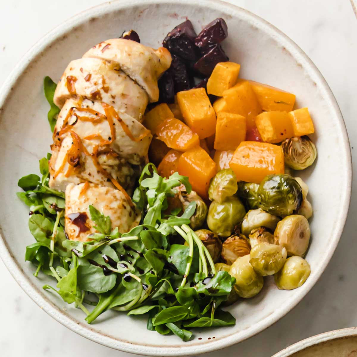 roasted chicken and vegetables on a plate