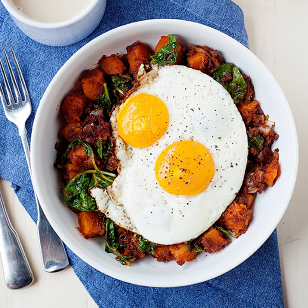 breakfast hash with two fried eggs on top