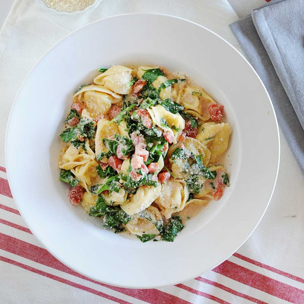 large bowl of spinach tortellini